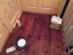 Use mineral spirits to remove wax from the wood floor