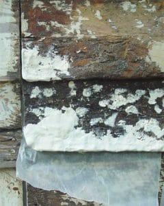 decayed wooden siding treated with an epoxy filler