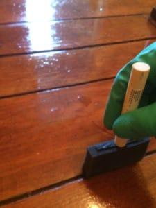 Using a sponge brush to apply the Waterlox finish