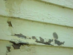 Layers of paint on wood siding on an historic house